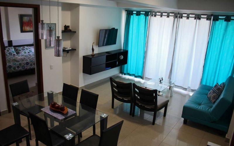 vista general de comedor sala y habitacion de apartamento 702 de edificio palmetto en bocagrande cartagena